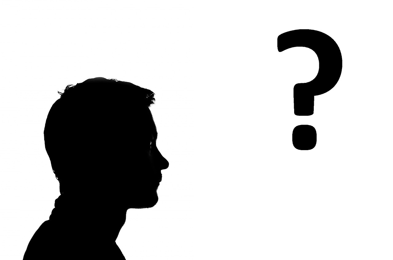 a person in silhouette with a question mark