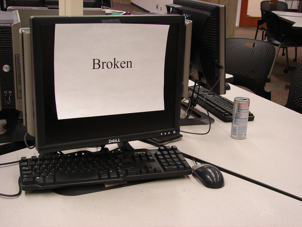 "computer screen with ""broken"" sign on it"