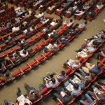 aerial view of many people seated at conference